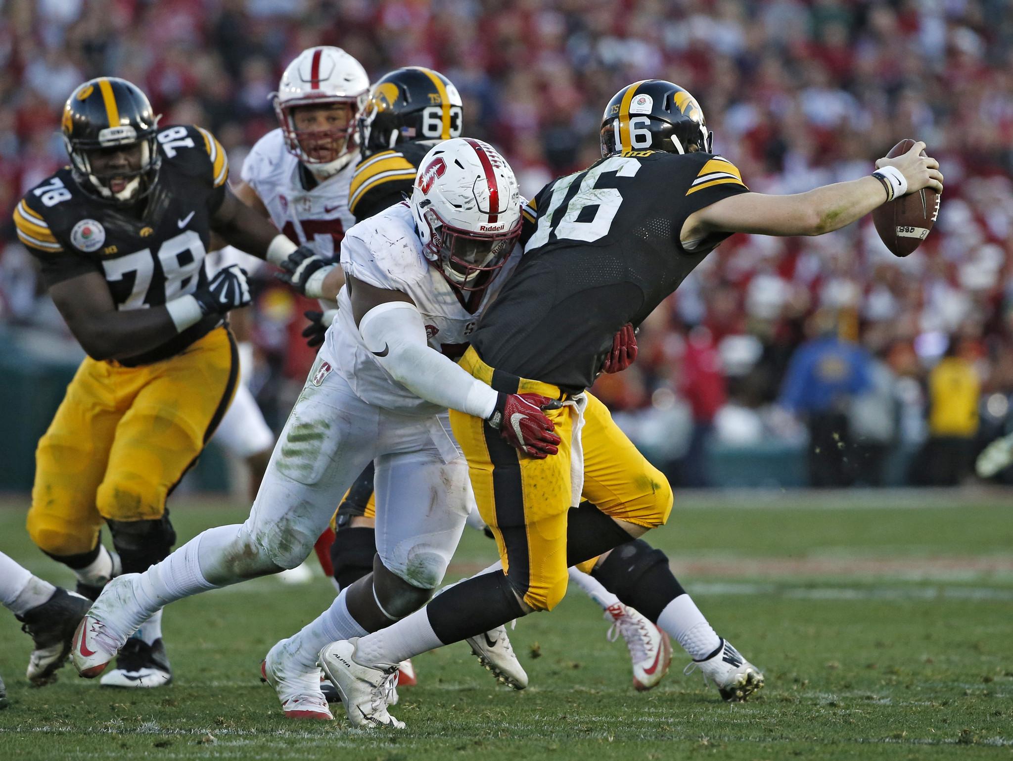 C.J. Beathard is sacked by Stanford defensive end Aziz Shittu. (Lenny Ignelzi / AP Photo)