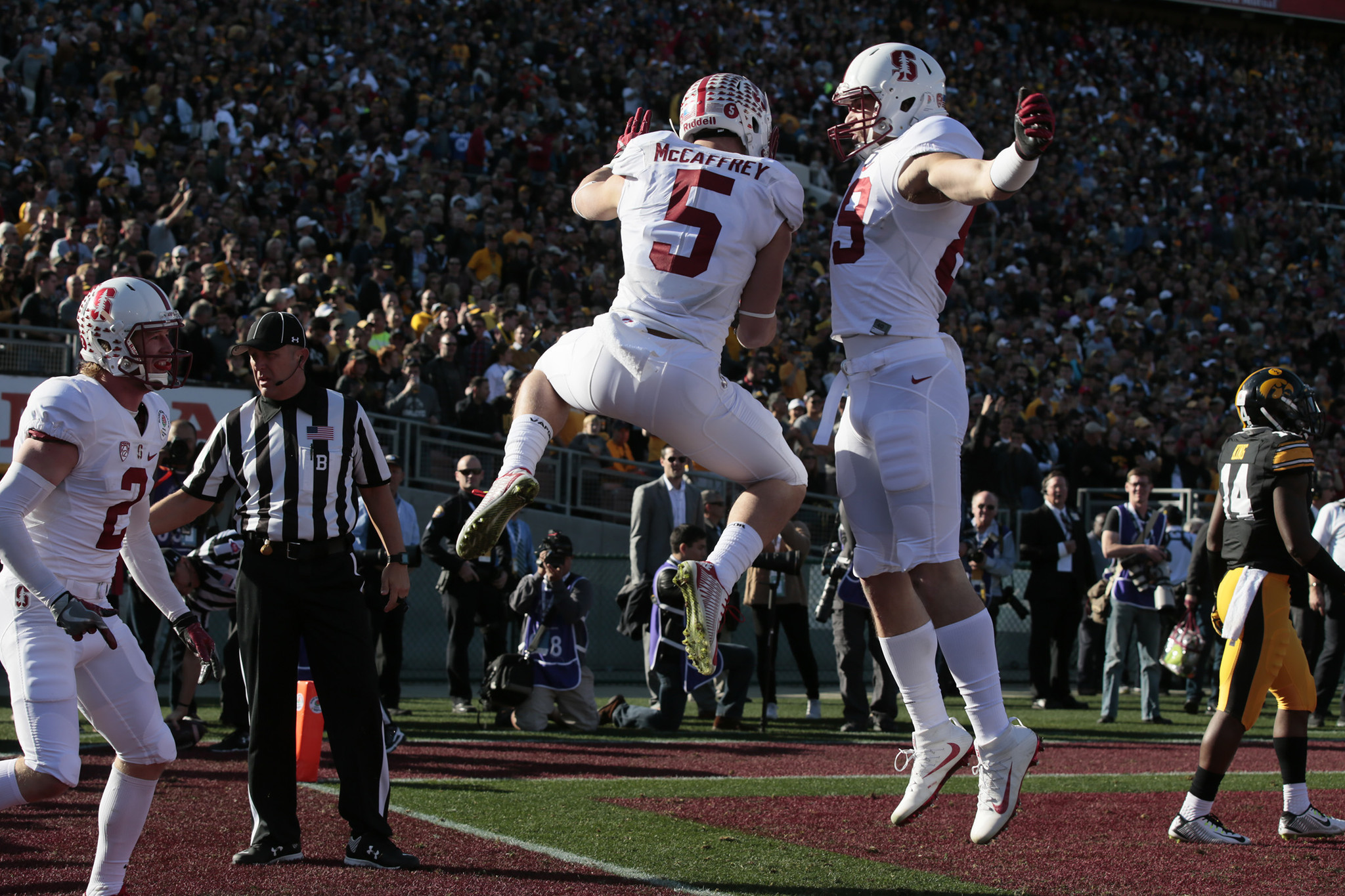 Christian McCaffrey celebrates with teammate. (Robert Gauthier / Los Angeles Times)
