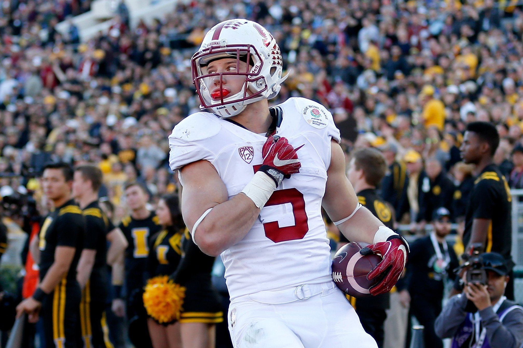 Christian McCaffrey became the first player in Rose Bowl history to tally more than 100 yards rushing and receiving. (Sean M. Haffey / Getty Images)