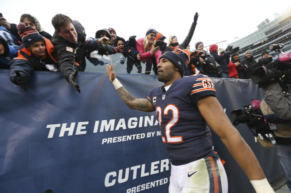 <p>Matt Forte high-fives fans before walking off the field following his team's 24-20 loss to the Lions at Soldier Field.</p>
