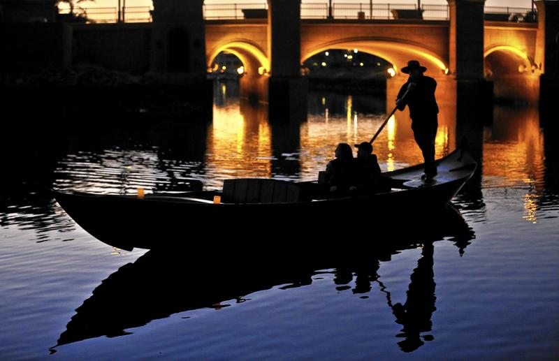 Visitors to Oxnard can take a gondola ride in Channel Islands Harbor. (Mel Melcon / Los Angeles Times)