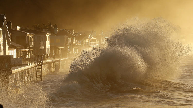 Heavy surf slams the homes at Mondos Beach between the Solimar and Faria Beach communities in Ventura County early Thursday morning. (Al Seib / Los Angeles Times)
