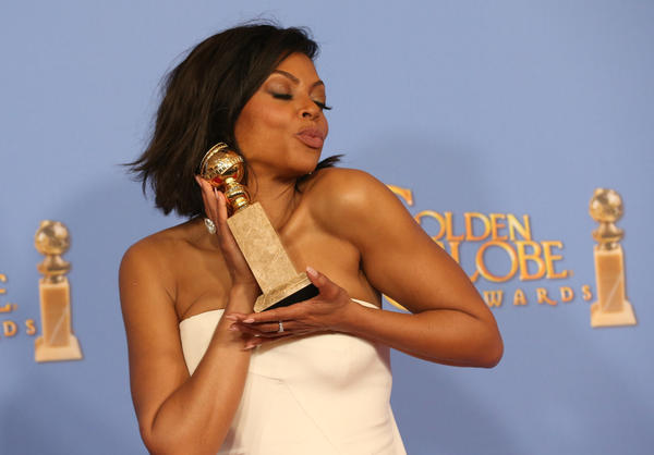 """Empire"" star Taraji P. Henson shows off her Golden Globe. (Allen J. Schaben / Los Angeles Times)"