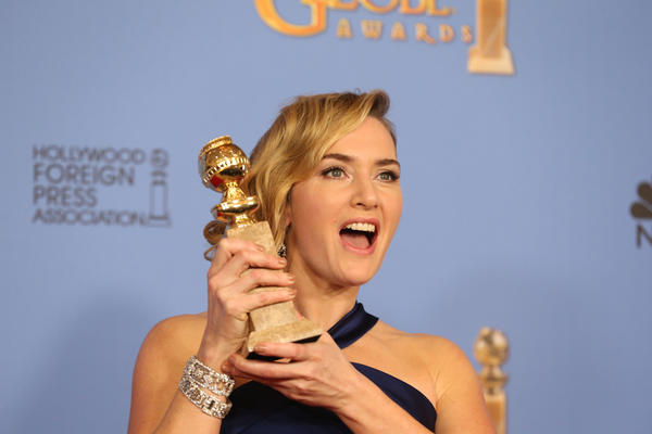 """Steve Jobs"" actress Kate Winslet accepts her Golden Globe for supporting actress in a film - drama at the 73rd Golden Globes at the Beverly Hilton Hotel. (Allen J. Schaben / Los Angeles Times)"