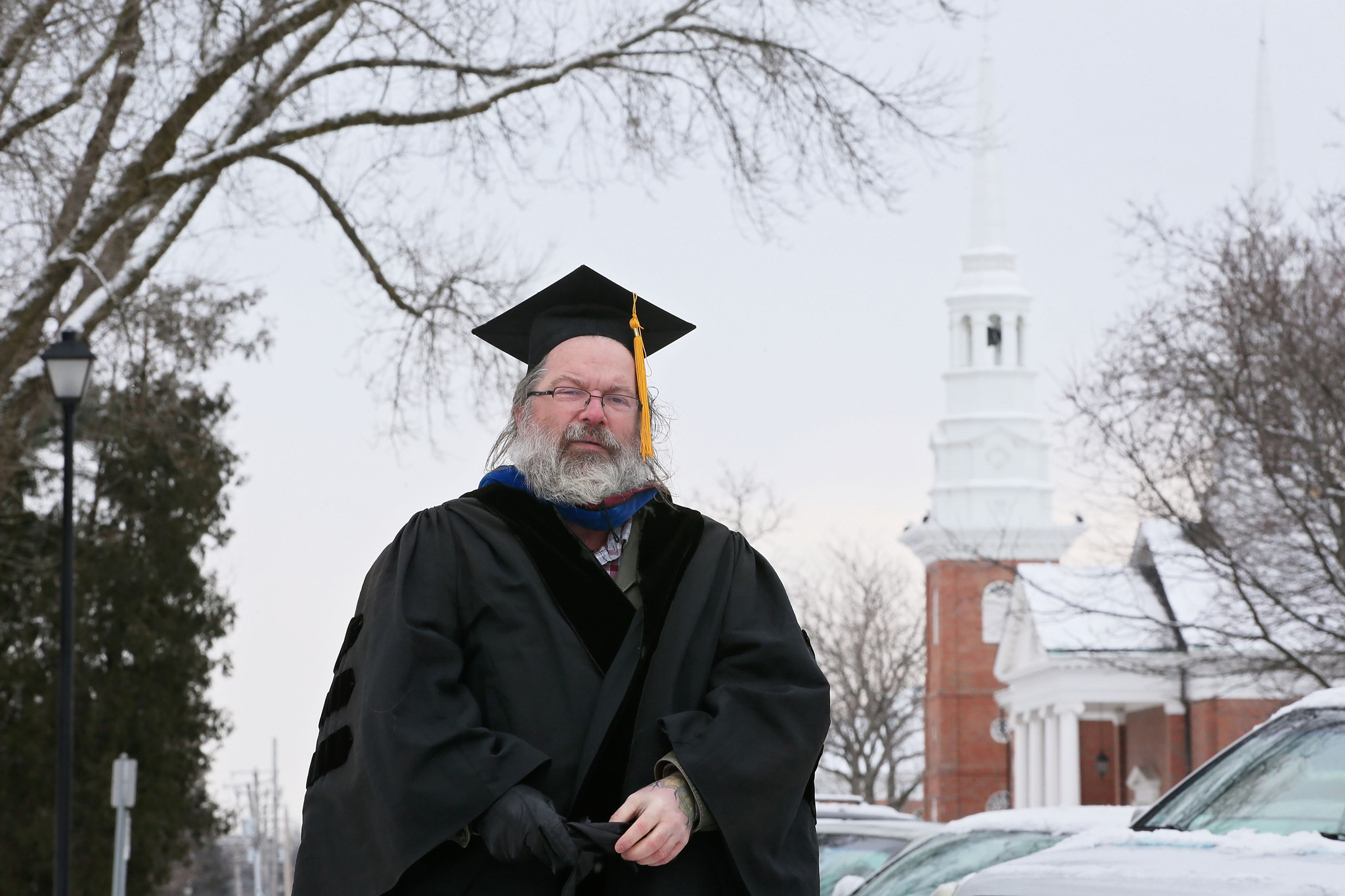 Wheaton College professor wearing cap, gown in support of colleague ...