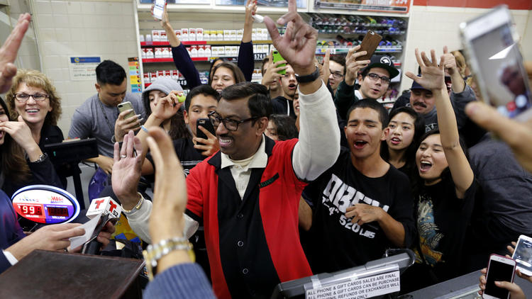 Residents of Chino Hills crowd into a 7-Eleven, where one of the winning tickets of a record Powerball jackpot was sold. Employee M. Faroqui, center, sold the winning ticket.