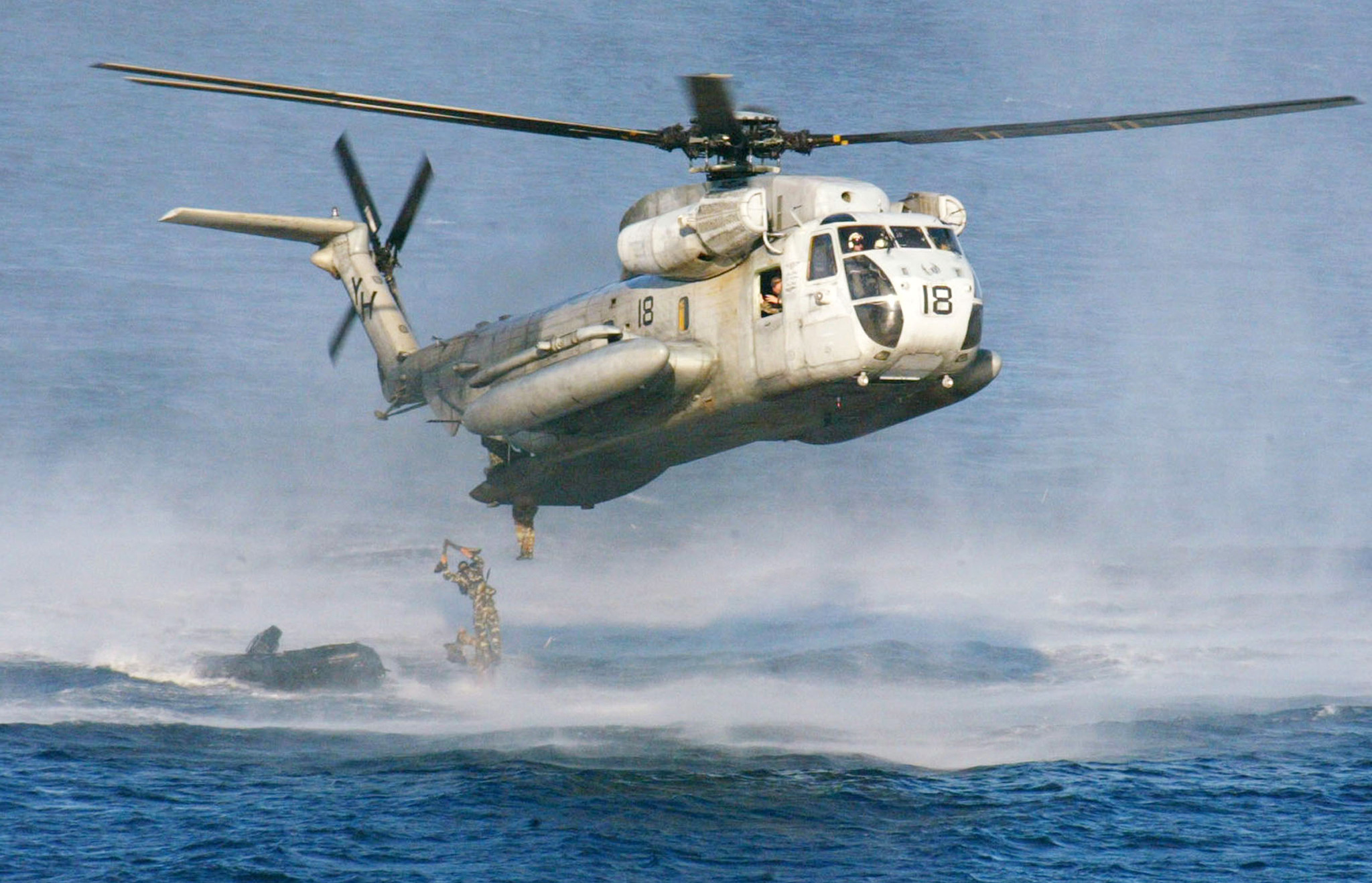 Rescuers look for 12 aboard Marine helicopters that collided off Hawaii