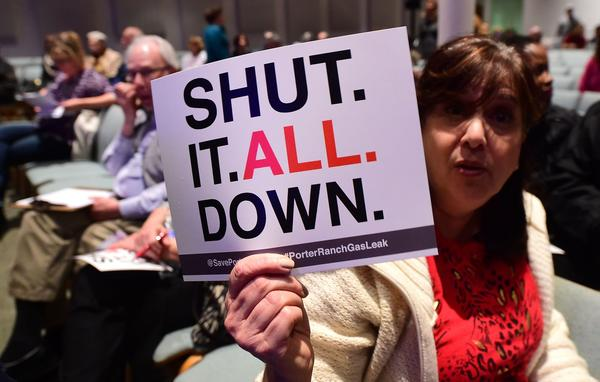 Sheryl Goldfarb, who said she has lived in Porter Ranch for 27 years, holds a placard expressing her feelings at a town hall meeting about the gas leak at Shepard of the Hills Church on Friday. (Frederic J. Brown / AFP/Getty Images)