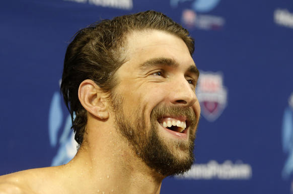 <p>Michael Phelps smiles after winning the men's 200-meter individual medley during the Arena Pro Swim Series on Sunday night.</p>