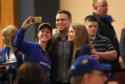 <p>Cubs President of baseball operations Theo Epstein, center, takes a selfie with fans during the 2016 Cubs Convention.</p>