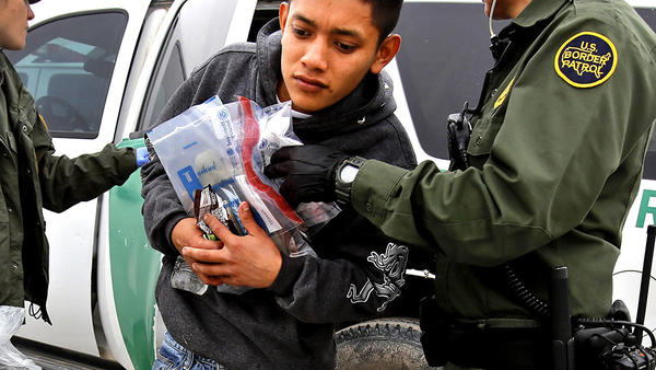 A 17-year-old Guatemalan gets out of a U.S. Border Patrol vehicle south of McAllen, Texas. (Michael Robinson Chavez / Los Angeles Times)
