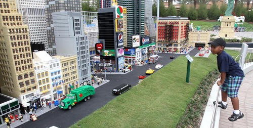 <p>A young guest, 4-year-old Josian Wright of Apopka, checks out the New York skyline in Miniland USA as special guests preview Legoland Florida as a part of the park's soft-opening, Thursday, October 6, 2011. The park officially opens to the public, October 15.</p>