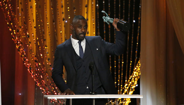 Idris Elba with his SAG Award for male actor in a supporting role at the 22nd Screen Actors Guild Awards. (Robert Gauthier / Los Angeles Times)