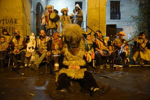 """<p>A man disguised as """"Intxixu"""" takes part in the ancient carnival of Oiartzun on January 31, 2016. """"Intxixuak"""" come from the mountains wearing sheepskins and big horns and appear at the main square of Oiartzun dancing and jumping around a bonfire. </p>"""
