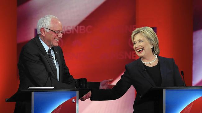 The only remaining Democratic candidates, Bernie Sanders and Hillary Clinton, share a friendly exchange during an often-heated debate in Durham, N.H. (Justin Sullivan / Getty Images)