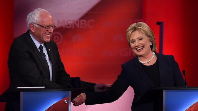 Democratic presidential candidates Bernie Sanders and Hillary Clinton shake hands during a debate Thursday at the University of New Hampshire in Durham. (Jewel Samad / AFP/Getty Images)