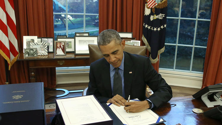 President Obama signs a year-end budget deal at the White House, funding government through September. None