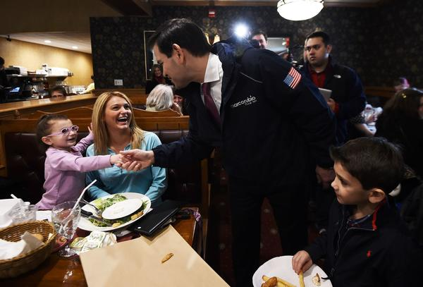 Marco Rubio greets diners in Manchester, N.H. (Jewel Samad / AFP-Getty Images)