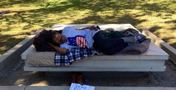 A homeless man rests outside the Hall of Administration, where L..A. County supervisors were discussing a new plan to end homelessness. (Carla Hall / Los Angeles Times)