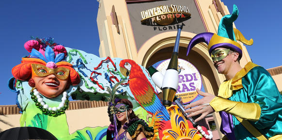 Dancers and entertainers perform at the entrance to Universal Studios Florida on Fat Tuesday, February 9, 2016, to promote their annual Mardi Gras celebration, which runs through April 16, 2016. For a complete guide to the Mardi Gras concerts, parades and events at Universal Orlando, check out the Orlando Sentinel's Mardi Gras Readers Guide upcoming in Friday's Calendar section. (Joe Burbank/Orlando Sentinel)   B585307116Z.1