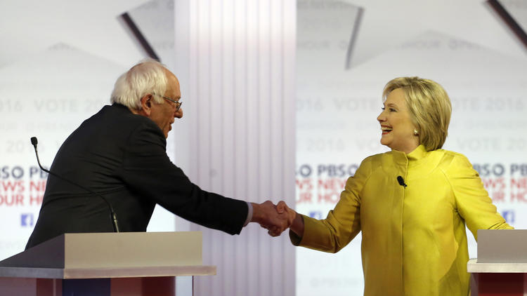 Bernie Sanders and Hillary Clinton shake hands after Thursday's debate in Milwaukee. (Morry Gash / Associated Press)