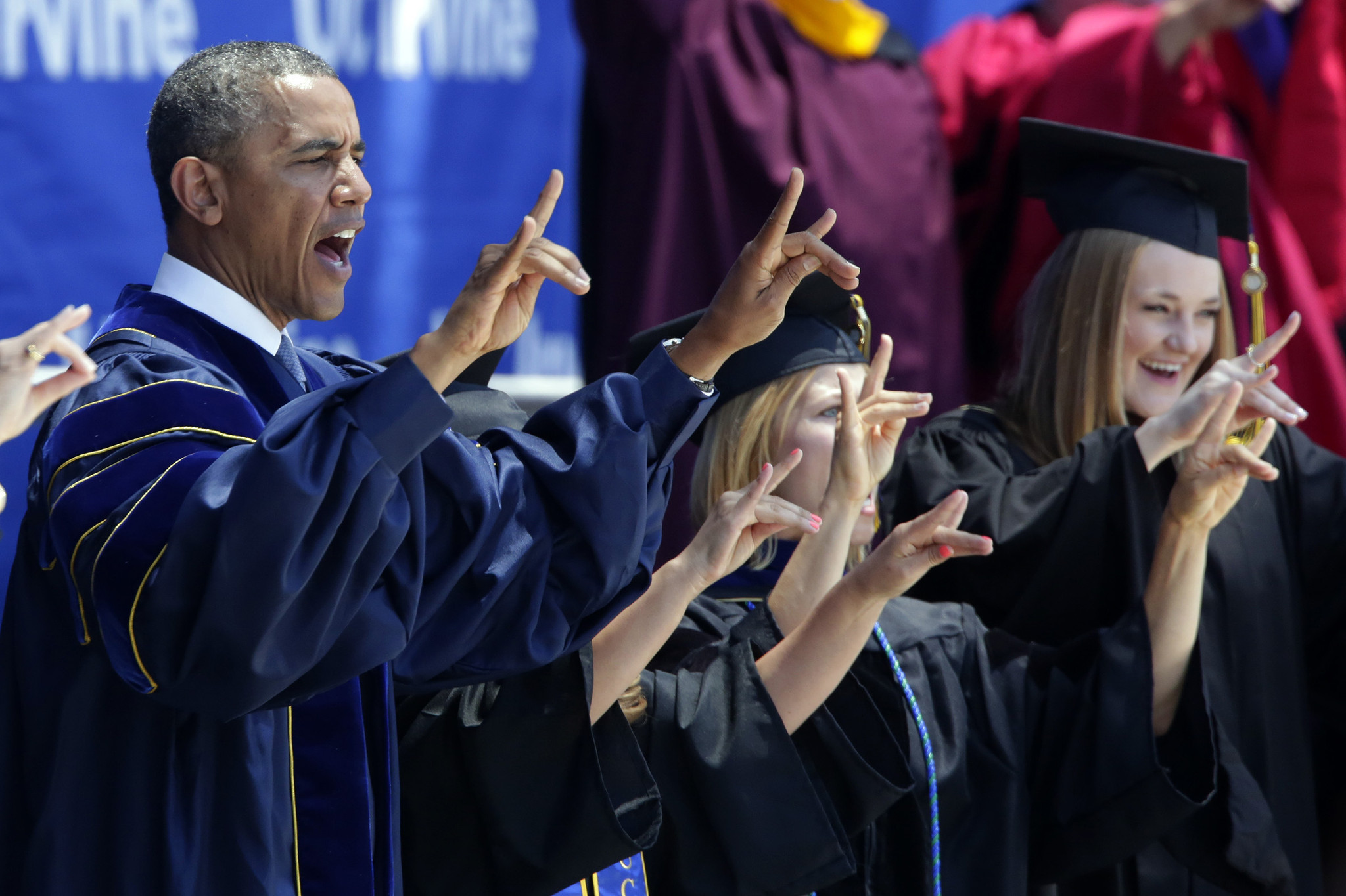 President Obama joins others in making the Anteater sign and sound at UC Irvine's commencement ceremony on June 14, 2014, at Angel Stadium in Anaheim. President Obama's address kicked off the campus' 50th anniversary celebration. The university's first commencement speaker was President Lyndon B. Johnson, who dedicated the campus site on June 20, 1964.