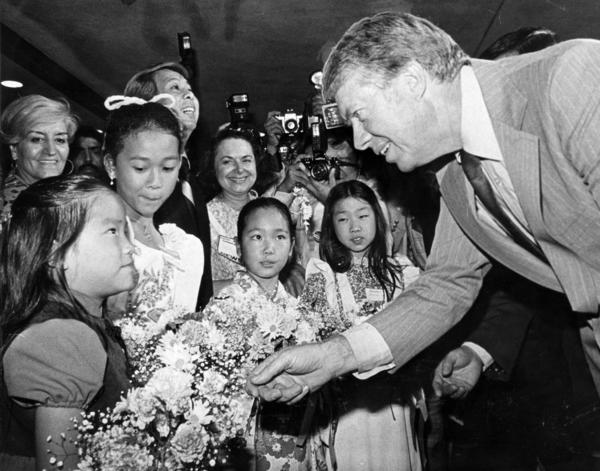 Jimmy Carter chats with Annette Lee, 6, and other youngsters in front of Jade West Restaurant during a presidential campaign stop in Century City in October 1976.