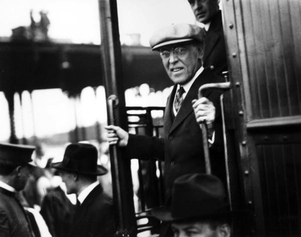President Wilson steps from a train during his arrival in Los Angeles in 1919. His train continued to his next stop in San Diego, returning the next day for a parade in Los Angeles.