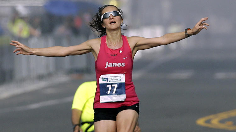 Julia Budniak nears the finish line of the L.A. Marathon. (Chris Carlson / Associated Press)