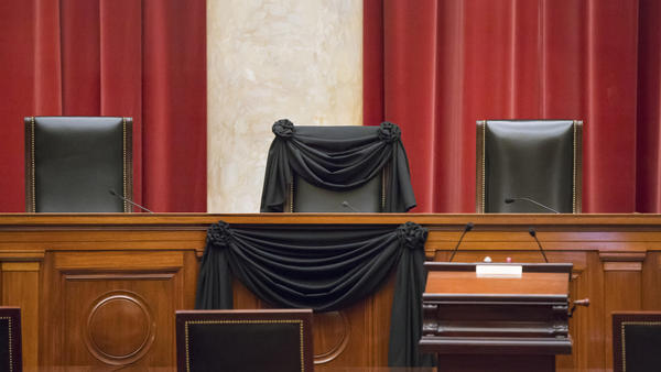 Scalia's chair draped in black