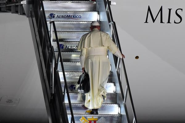 Pope Francis boards a plane for Rome. (Ronaldo Schemidt / AFP-Getty Images)