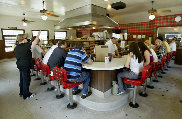 The busy counter at The Apple Pan on Pico Blvd. dates from 1949, and serves nothing but burgers, sandwiches and pies.