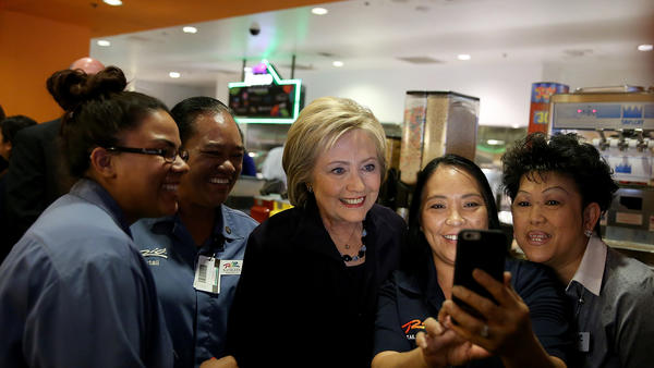 Hillary Clinton takes a selfie with service workers at Rio All-Suite Las Vegas Hotel and Casino on Thursday. (Justin Sullivan / Getty Images) None