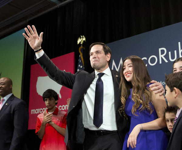 Marco Rubio and his daughter Amanda during an election-night rally Saturday in Columbia, S.C. (John Bazemore / AP)