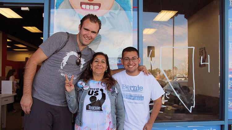 Yolanda Gonzalez, center, poses with fellow Californians and Bernie Sanders supporters James Albert, left, and Ronaldo Lizárraga-Angulo, right. (Christine Mai-Duc / Los Angeles Times) None