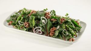 Salad of beet greens with walnuts