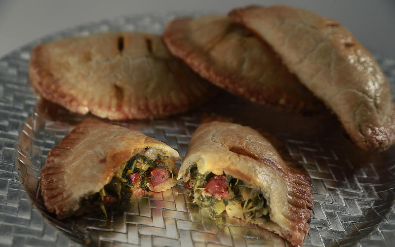 Hand pies with mustard greens and Spanish chorizo