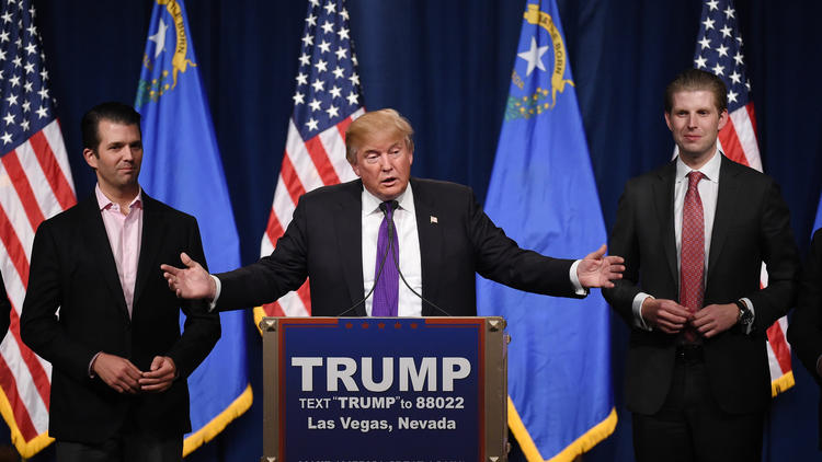 Republican presidential candidate Donald Trump  speaks Tuesday night with his sons Donald Trump Jr., left, and Eric Trump at a Las Vegas celebration of his victory in the Nevada caucuses. (Ethan Miller / Getty Images)