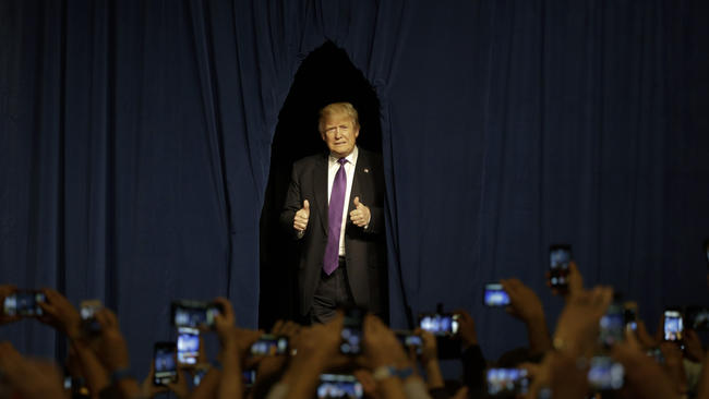 Republican presidential candidate Donald Trump arrives for a caucus night rally Tuesday in Las Vegas.  (Jae C. Hong / AP) None