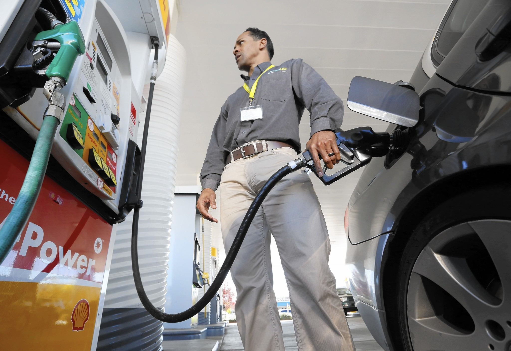 Eric Henry buys gas in Sacramento in March 2014. (Rich Pedroncelli / Associated Press)