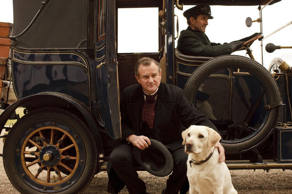 Lord Grantham (Hugh Bonneville) with his trusty yellow lab, Pharaoh.