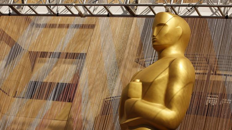 A colorful chain curtain is the backdrop for a giant Oscar statue at Hollywood and Highland earlier this year. (Al Seib / Los Angeles Times)