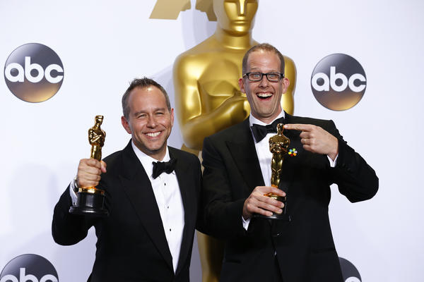 "Jonas Rivera and Pete Docter, with their Oscars for best animated feature film, ""Inside Out,"" backstage at the 88th Academy Awards. (Marcus Yam/ Los Angeles Times)"