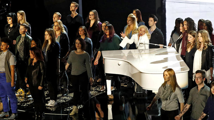 Robert Gauthier / Los Angeles Times Lady Gaga and abuse survivors at 2016 Academy Awards.