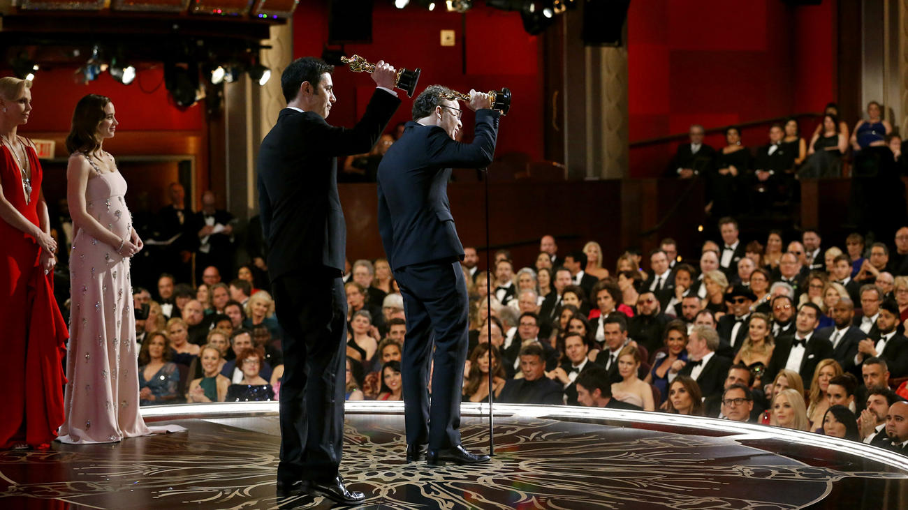 "Josh Singer and Tom McCarthy accept the award for Original Screenplay for ""Spotlight."""