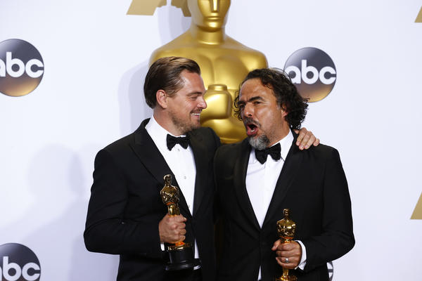 "Leonardo DiCaprio, winner of the award for best actor in a leading role for ""The Revenant"", left, and Alejandro G. Inarritu, winner of the award for best director for ""The Revenant"". (Marcus Yam / Los Angeles Times)"