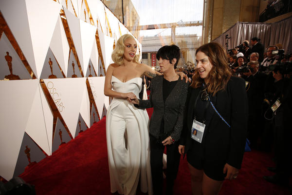 "Lady Gaga and Diane Warren, center, during the arrivals at the 88th Academy Awards. They were nominated together for ""Til It  Happens to You,"" from the film ""The Hunting Ground."" (Al Seib/ Los Angeles Times)"