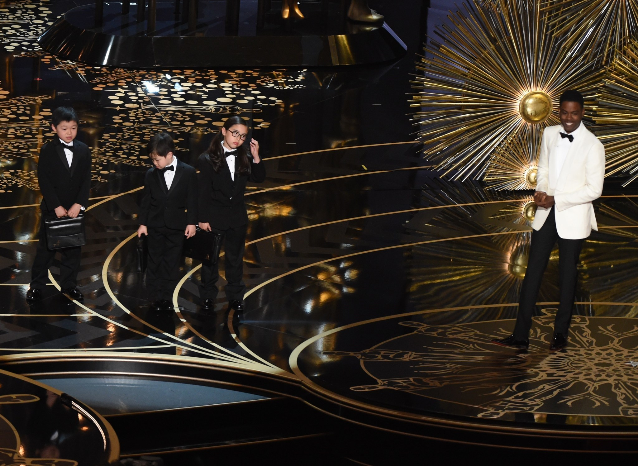 Big event red curtains with spotlight stock photo getty images - Oscars Host Chris Rock Introduces Children Representing Pricewaterhousecoopers Accountants At The 88th Oscars On Sunday
