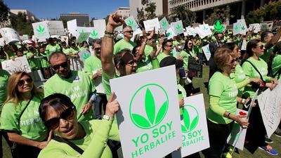 Herbalife cuts 2015 customer growth in half, blaming database error