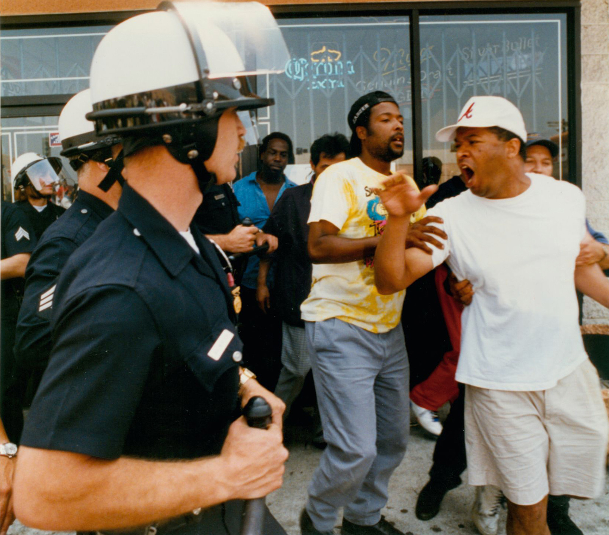 An argument between police and civilians preceding a rock- and brick-throwing incident at the corner of Vermont Avenue and 1st Street in Los Angeles on April 30, 1992.